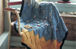 Plaid aux motifs nautiques à tricoter